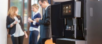 people using automatic office coffee machine