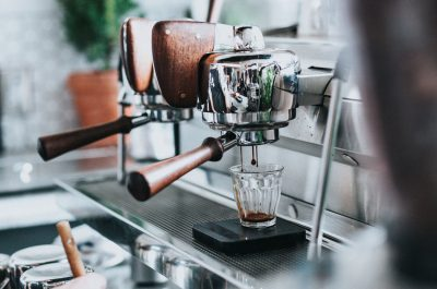 Commercial coffee machine brands, coffee machine dispensing coffee into glass cup